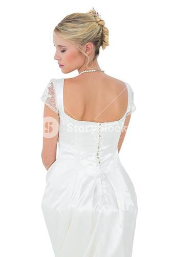 Bride with eyes closed over white background