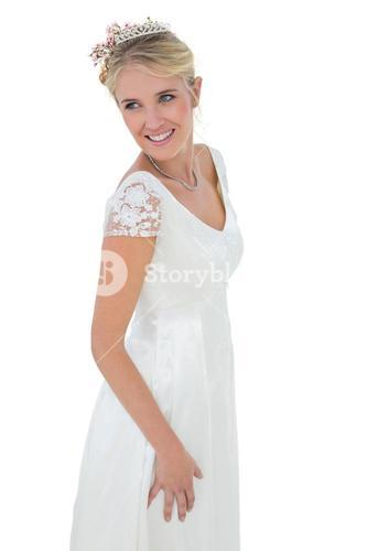 Happy thoughtful bride standing against white background