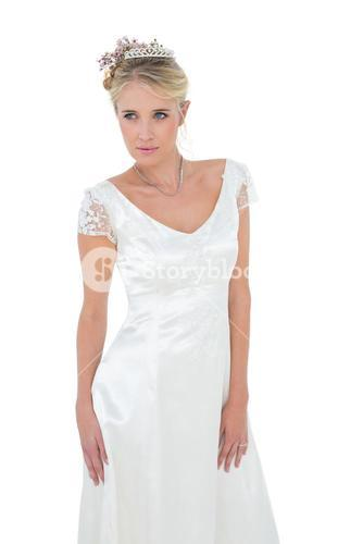 Bride day dreaming against white background
