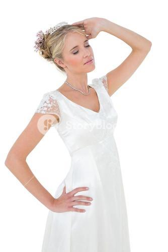 Bride with eyes closed against white background