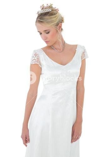 Shy bride with eyes closed against white background