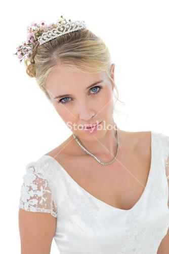 Close-up of bride over white background