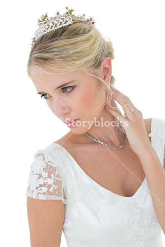 Thoughtful young bride looking away