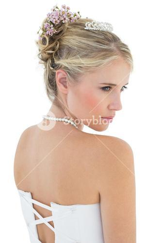Rear view of thoughtful bride in off shoulder dress