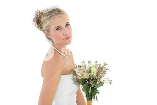 Bride with flower bouquet over white background