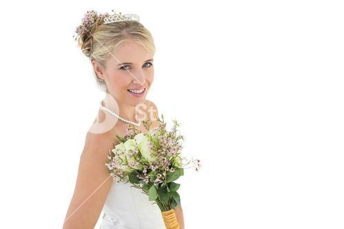 Happy bride with flower bouquet over white background