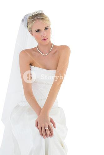 Beautiful bride in off shoulder dress against white background
