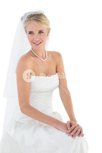 Thoughtful bride smiling against white background