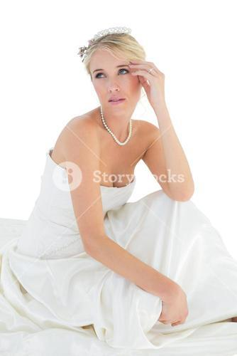 Thoughtful bride looking away