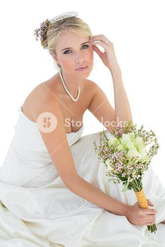 Sensuous bride holding rose bouquet over white background