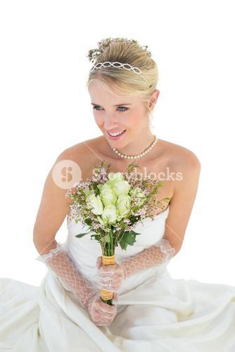 Thoughtful bride over white background