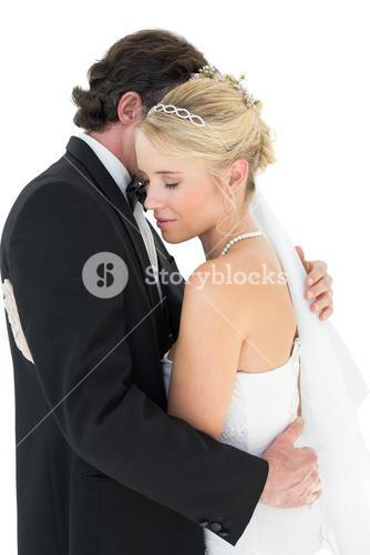 Affectionate bride and groom embracing