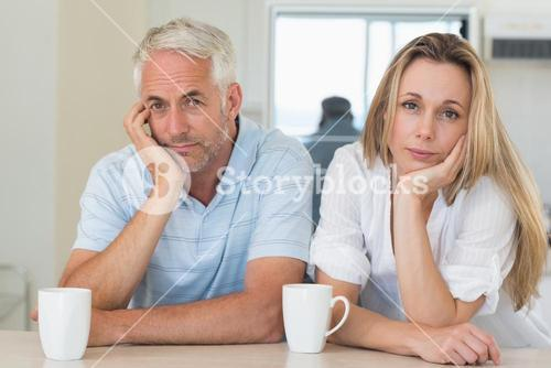 Fed up couple sitting at the counter
