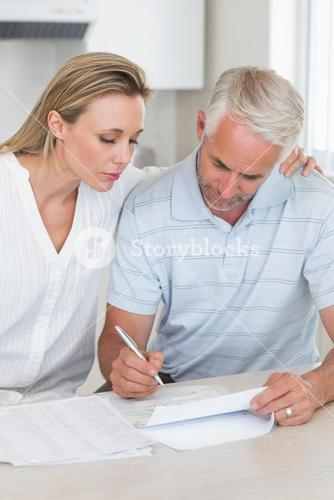 Serious couple working out their finances
