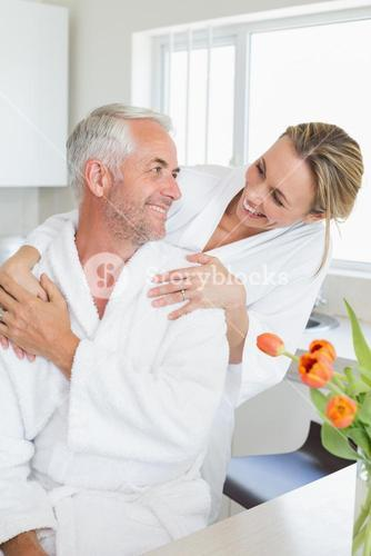 Happy couple embracing in the morning