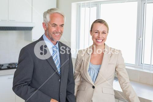 Happy business couple before work in morning