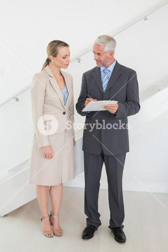 Estate agent going over contracts with customer