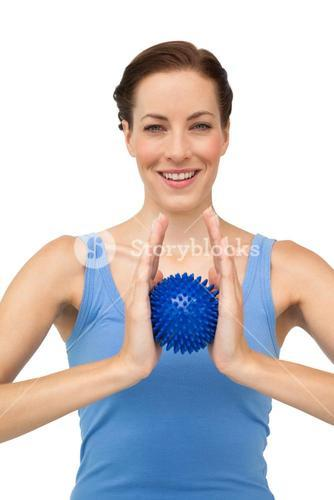 Portrait of a content young woman holding stress ball