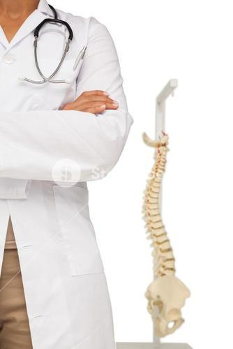 Mid section of a female doctor with skeleton model