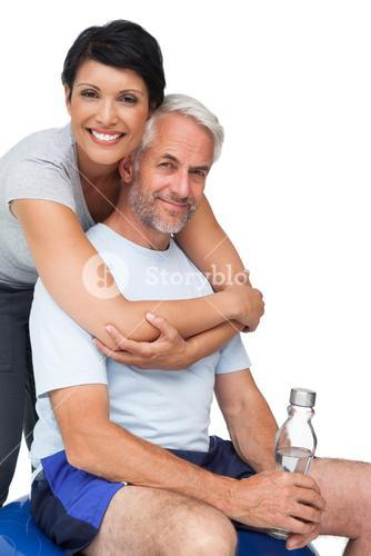 Portrait of a happy woman embracing man