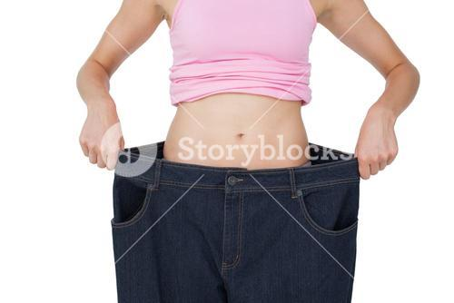 Mid section of beautiful females body in old jeans