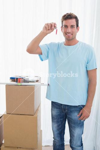 Young man holding new house key