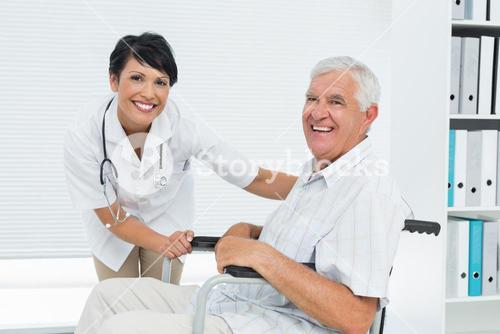 Female doctor with senior patient in wheelchair