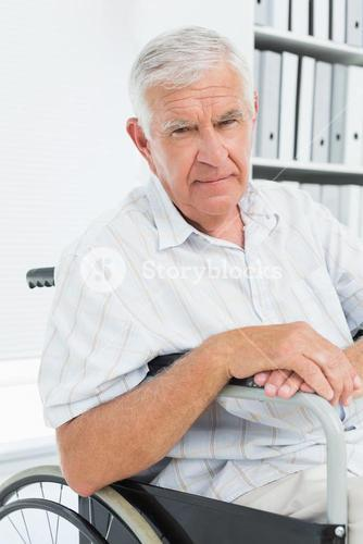 Portrait of a sad senior man sitting in wheelchair