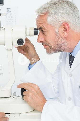 Senior optician in examination room