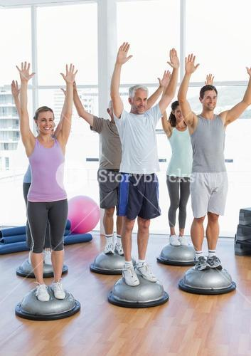 Smiling people doing power fitness exercise