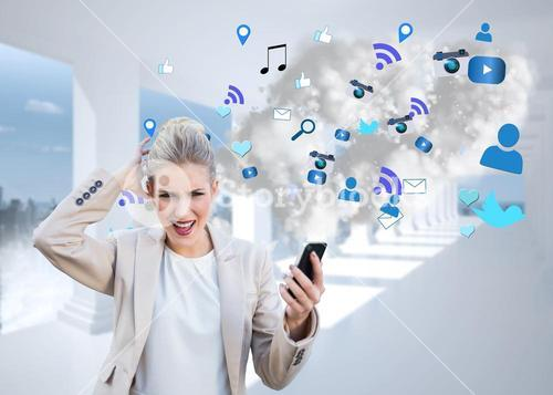 Angry businesswoman holding smartphone with cloud computing graphic
