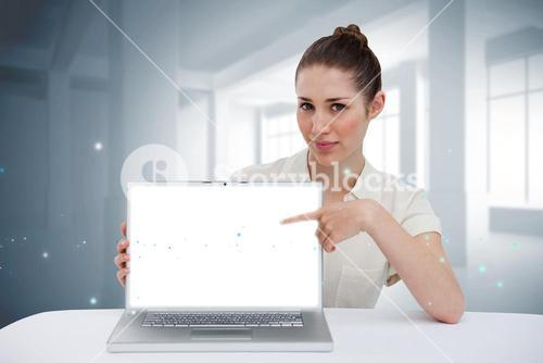 Businesswoman pointing to her laptop