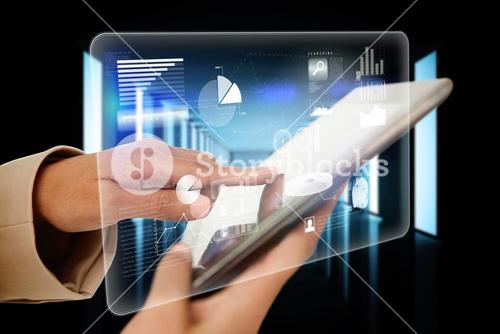 Businesswoman touching tablet with interface