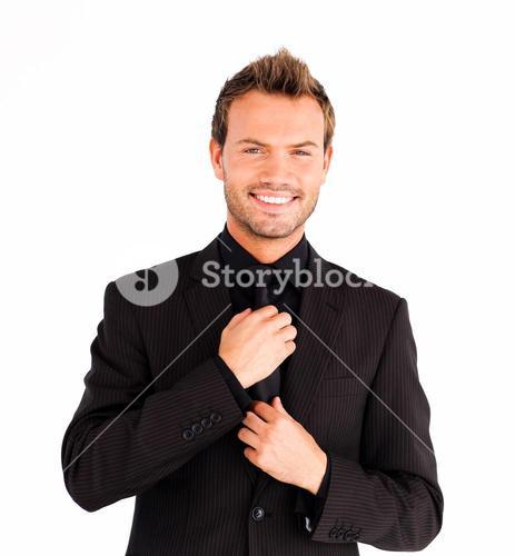 Attractive businessman corrects a tie