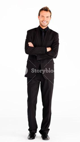 Happy businessman with folded arms