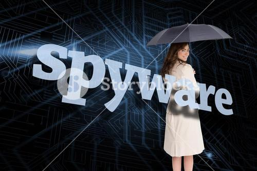 Businesswoman holding umbrella behind the word spyware