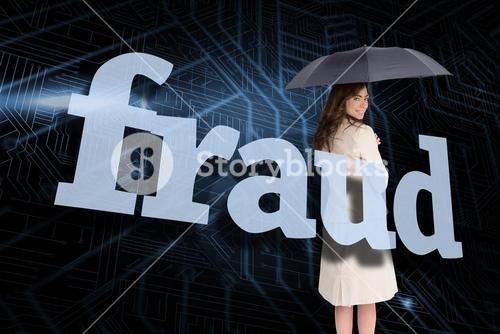 Businesswoman holding umbrella behind the word fraud