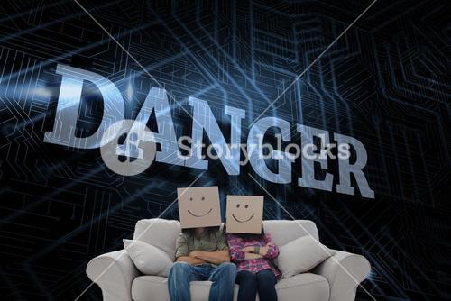 Danger against futuristic black and blue background