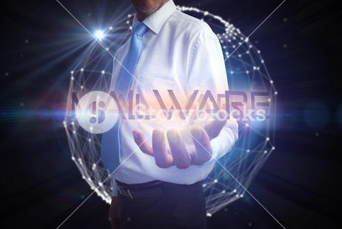 Businessman presenting the word malware