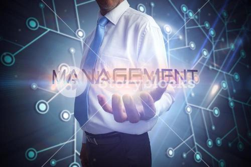 Businessman presenting the word management