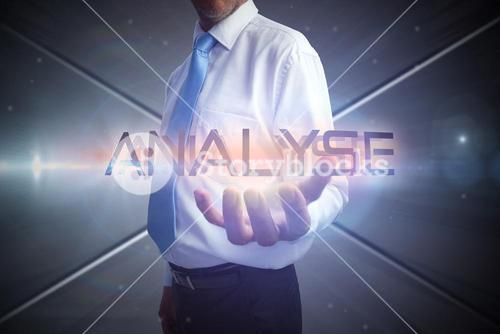 Businessman presenting the word analyse