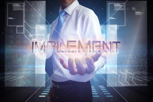 Businessman presenting the word implement