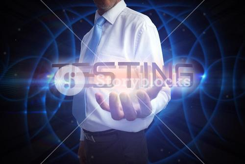 Businessman presenting the word testing