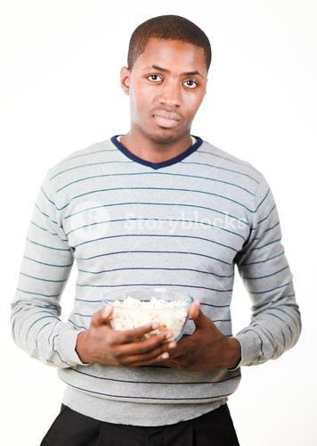 Man holding pop corn