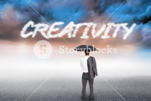 Creativity against cloudy landscape background
