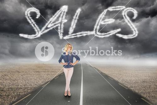 Sales against misty brown landscape with street