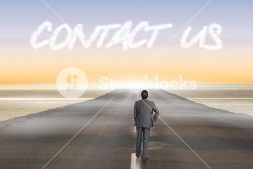 Contact us against road leading out to the horizon