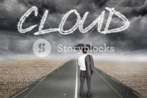 Cloud against misty brown landscape with street