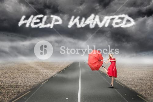Help wanted against misty brown landscape with street