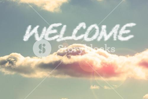 Welcome against bright blue sky with cloud